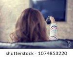 beautiful woman lying on a sofa ... | Shutterstock . vector #1074853220