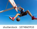 slam dunk. side view of young... | Shutterstock . vector #1074865910