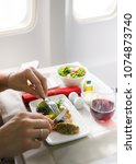 food served in the airplane...   Shutterstock . vector #1074873740