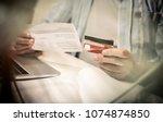 senior business man checking... | Shutterstock . vector #1074874850