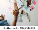 above view  real estate broker... | Shutterstock . vector #1074889400