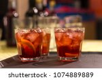 close up on cocktail glasses on ... | Shutterstock . vector #1074889889