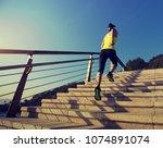 sporty fitness female runner... | Shutterstock . vector #1074891074