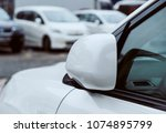 the rearview mirror of a white... | Shutterstock . vector #1074895799