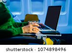 midsection of women with laptop ... | Shutterstock . vector #1074898496