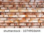 orange block wall background. | Shutterstock . vector #1074903644