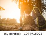 trail running at the sunset | Shutterstock . vector #1074915023