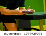 table tennis player serving ... | Shutterstock . vector #1074929078
