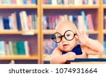 smart baby in glasses with book ... | Shutterstock . vector #1074931664
