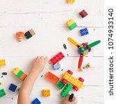 top view on child's hands... | Shutterstock . vector #1074933140