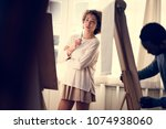 woman working on painting | Shutterstock . vector #1074938060