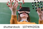 female student wearing virtual...   Shutterstock . vector #1074942026