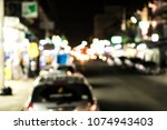 blurred car running on the... | Shutterstock . vector #1074943403