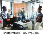 coworkers are thinking up a... | Shutterstock . vector #1074960503