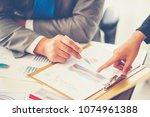 business adviser analyzing... | Shutterstock . vector #1074961388