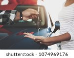 close up man is giving keys to... | Shutterstock . vector #1074969176