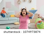 young nanny in despair and... | Shutterstock . vector #1074973874