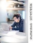 young asian business man... | Shutterstock . vector #1074978536