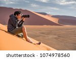 young asian man traveler and... | Shutterstock . vector #1074978560