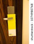flyer on the doorknob in the...   Shutterstock . vector #1074980768