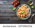 penne pasta in tomato sauce and ... | Shutterstock . vector #1074982256