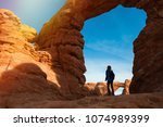 young woman traveler with... | Shutterstock . vector #1074989399