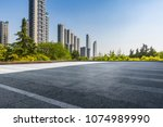 empty road with modern business ... | Shutterstock . vector #1074989990