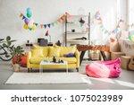 interior of cozy room decorated ... | Shutterstock . vector #1075023989