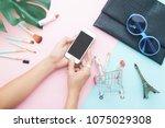 top view of woman's using... | Shutterstock . vector #1075029308