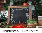 blank charcoal board among... | Shutterstock . vector #1075029824