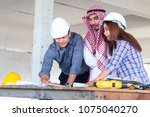 group of engineer checking the... | Shutterstock . vector #1075040270