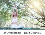 young woman exercising and... | Shutterstock . vector #1075040480