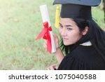 happy graduate young asian... | Shutterstock . vector #1075040588