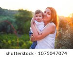 young beatiful woman with baby... | Shutterstock . vector #1075047074