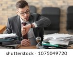 businessman looking at his... | Shutterstock . vector #1075049720