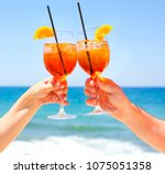 two cocktail glasses in the... | Shutterstock . vector #1075051358