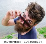 man with beard and mustache... | Shutterstock . vector #1075058174