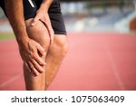 knee injuries. young sport man... | Shutterstock . vector #1075063409