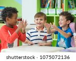 group of diversity kids boy sit ... | Shutterstock . vector #1075072136