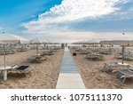 morning on the beach in rimini  ... | Shutterstock . vector #1075111370