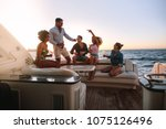 group of happy friends having a ... | Shutterstock . vector #1075126496