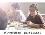 happy elderly twin senior... | Shutterstock . vector #1075126658