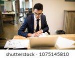 man intelligent economist... | Shutterstock . vector #1075145810