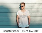 stylish young man with... | Shutterstock . vector #1075167809