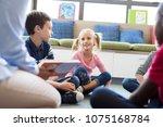 happy smiling girl listening... | Shutterstock . vector #1075168784