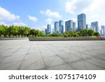 empty square floor and modern... | Shutterstock . vector #1075174109