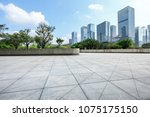empty square floor and modern... | Shutterstock . vector #1075175150