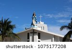 statue of the virgin mary on...   Shutterstock . vector #1075177208