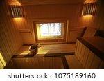 sauna  wooden interior baths ... | Shutterstock . vector #1075189160