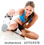 fit woman stretching her leg to